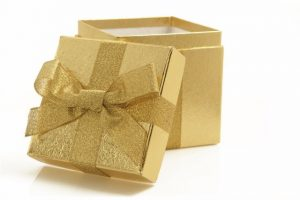 Gold box and gold ribbon birthday entertainment package