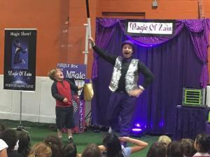 kids party magician zain performing magic