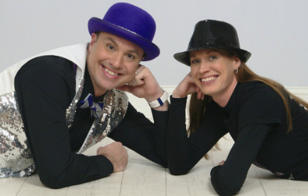 two magicians for kids parties smiling with hats
